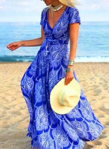 Niebieska sukienka Sandbella z dekoltem w kształcie litery v maxi