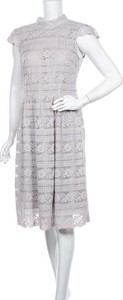 Sukienka Carolina Cavour z okrągłym dekoltem