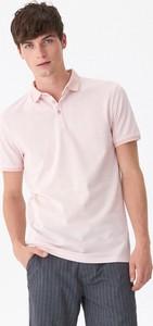 Różowa koszulka polo House z krótkim rękawem