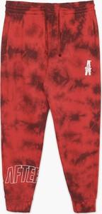 Czerwone spodnie sportowe Cropp z dresówki