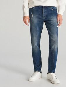 Granatowe jeansy Reserved