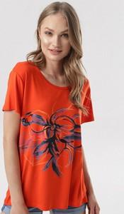 Pomarańczowa bluzka born2be z nadrukiem