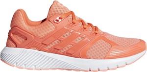 Pomarańczowe buty sportowe Adidas z płaską podeszwą