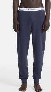 Niebieskie spodnie sportowe Calvin Klein w sportowym stylu