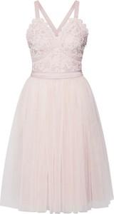 Różowa sukienka Chi Chi London rozkloszowana mini z szyfonu