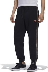 Czarne spodnie sportowe Adidas z dresówki w sportowym stylu