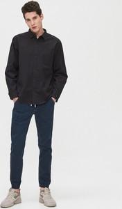 Granatowe spodnie Cropp