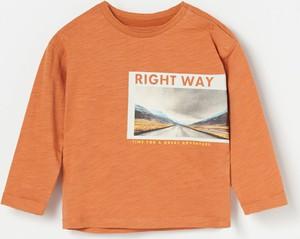 Pomarańczowa koszulka dziecięca Reserved z długim rękawem
