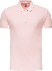 Różowa koszulka polo Tommy Jeans z krótkim rękawem