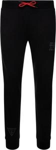Czarne spodnie sportowe Guess z dresówki