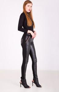 Czarne spodnie Zoio w młodzieżowym stylu