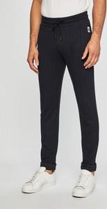 Spodnie Guess Jeans z dzianiny