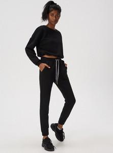 Spodnie sportowe Sinsay w sportowym stylu