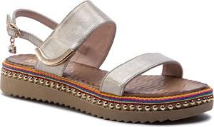 Złote sandały Carinii w stylu casual na niskim obcasie ze skóry