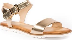 Złote sandały Neścior z klamrami w stylu casual z płaską podeszwą