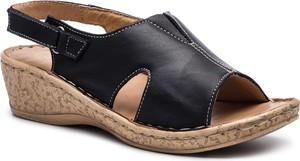Sandały Łukbut ze skóry na niskim obcasie na koturnie