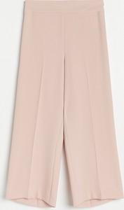 Różowe spodnie Reserved w stylu retro