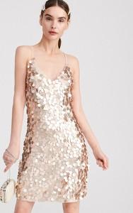 Złota sukienka Reserved w stylu glamour