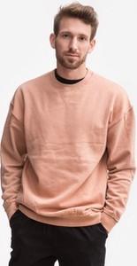 Różowa bluza Urban Classics z bawełny