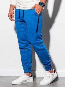 Niebieskie spodnie sportowe Ombre z dresówki