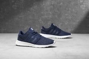 Niebieskie buty sportowe Adidas z płaską podeszwą