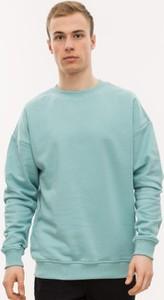 Miętowa bluza Urban Classics z bawełny