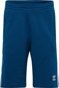 Niebieskie spodenki Adidas Originals z bawełny