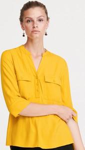 Żółta bluzka Reserved z długim rękawem