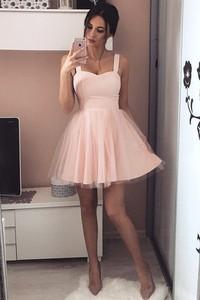 Różowa sukienka IVET.PL rozkloszowana