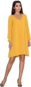 Żółta sukienka sukienki.pl oversize z długim rękawem midi