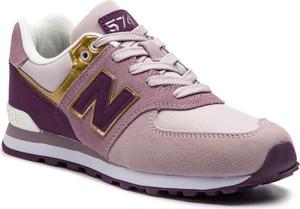 Różowe buty sportowe New Balance w sportowym stylu ze skóry na koturnie