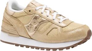 Złote buty sportowe Saucony ze skóry w sportowym stylu sznurowane