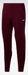 Czerwone spodnie sportowe Reebok Fitness z bawełny