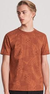 Pomarańczowy t-shirt Reserved z krótkim rękawem z nadrukiem