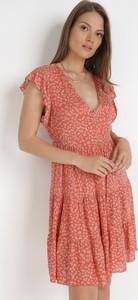 Pomarańczowa sukienka born2be mini trapezowa