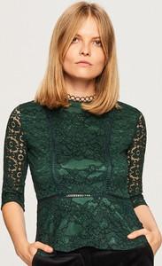 Turkusowa bluzka Reserved z okrągłym dekoltem