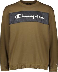 Zielona bluza Champion w młodzieżowym stylu