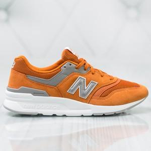Pomarańczowe buty sportowe New Balance w sportowym stylu sznurowane