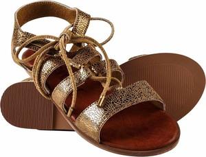 Złote sandały Superdry z płaską podeszwą