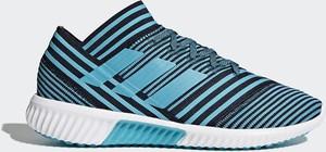 Niebieskie buty sportowe Adidas sznurowane w sportowym stylu
