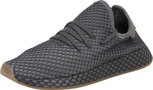 Granatowe buty sportowe Adidas Originals w młodzieżowym stylu