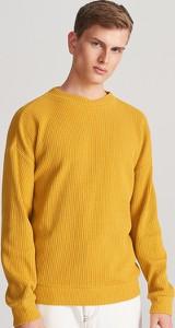 Żółta bluza Reserved z dzianiny