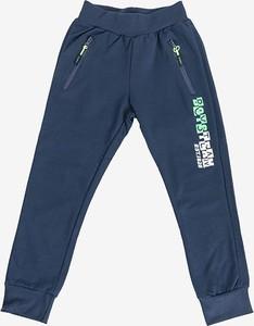 Granatowe spodnie dziecięce Royalfashion.pl dla chłopców