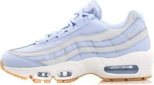 Niebieskie buty sportowe Nike w młodzieżowym stylu