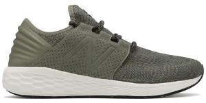 Zielone buty sportowe New Balance w sportowym stylu