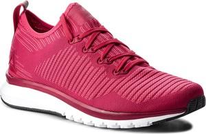 Czerwone buty sportowe Reebok z płaską podeszwą w sportowym stylu