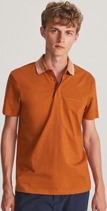 Pomarańczowa koszulka polo Reserved z krótkim rękawem