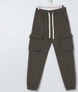 Zielone spodnie sportowe Sinsay