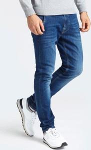 Niebieskie jeansy Guess z bawełny