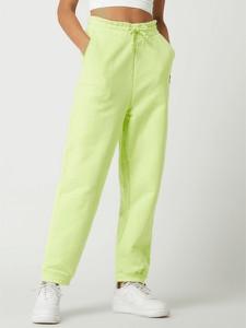 Żółte spodnie Tommy Jeans w sportowym stylu z bawełny